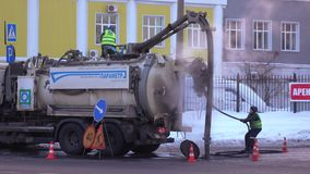 Sewage machine on the street. MOSCOW, RUSSIA - FEBRUARY 09, 2018: TWork on the removal of feces on the streets of the city in February 2018 in Moscow Russian stock footage