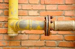 Sewage Pipe on the outside of a brick wall Royalty Free Stock Image