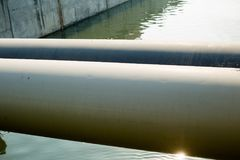 Sewage pipe. On the rivern Stock Images