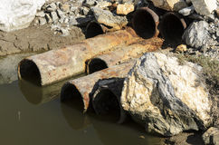 Sewage pollution. Pipes for the collection of polluted waters Royalty Free Stock Image