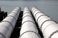 Sewage system. Over the river water Stock Photography