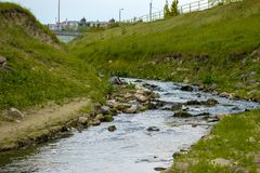 Sewage Water flowing into the river Stock Photo