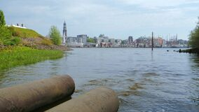 Sewage water or municipal waste release water into river.