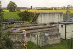 Sewage water station. Waste water treatment plant in  the countryside Royalty Free Stock Photography