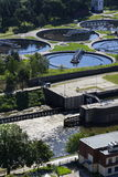 Sewage water treatment plant with river in background aerial Royalty Free Stock Photos