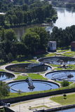 Sewage water treatment plant with river in background aerial Royalty Free Stock Image