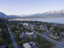 Seward, Alaska - Aerial. The small coastal town of Seward, Alaska, cloaked in the shadow of mountains Royalty Free Stock Images