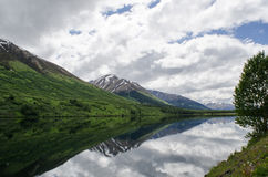 Seward Highway Reflection 1. A still, sunny day in Alaska created the perfect reflections in a lake on the roadside Royalty Free Stock Images