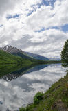 Seward Highway Reflections 2. A still, sunny day in Alaska created the perfect reflections in a lake on the roadside Stock Photos