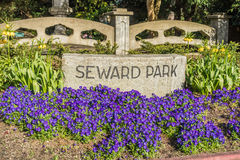 Seward Park Sign. A sign is surrounded by flowers at the entrance to Seward Park in Seattle, Washington Stock Image