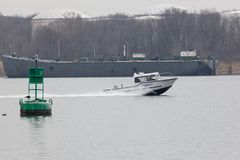 Atlantic Response Boat in Arthur Kill. SEWAREN, NEW JERSEY - April 5, 2017: An Atlantic Response Inc. boat travels the Arthur Kill in Woodbridge on a hazy day. A Royalty Free Stock Images