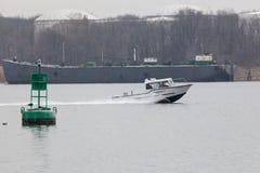 Atlantic Response Boat in Arthur Kill. SEWAREN, NEW JERSEY - April 5, 2017: An Atlantic Response Inc. boat travels the Arthur Kill in Woodbridge on a hazy day. A royalty free stock images