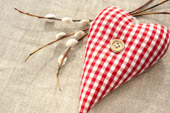 Sewed cotton love heart with spring willow twig Royalty Free Stock Image