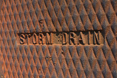 Sewer. A close-up of a sewer drain cover royalty free stock photos