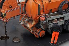 Sewer cleaning royalty free stock images