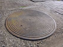 Sewer drain lid. Royalty Free Stock Images