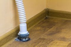 Sewer drain pipe under the kitchen sink.  royalty free stock photo