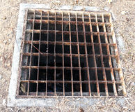 Sewer drain on the road Stock Photo