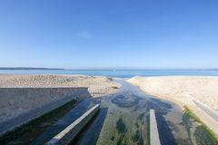 Sewer drainage in river reaching and polluting the Mediterranean. Ocean outside Palma de Mallorca, Spain stock image