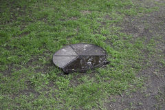 Sewer hatch with metal lid Royalty Free Stock Image