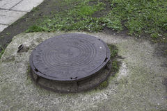 Sewer hatch with metal lid Royalty Free Stock Photos