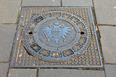 Sewer lid with coat of arms of the city of cologne Stock Image