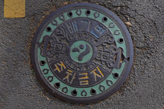 Sewer lid in Seoul South Korea, Asia - NOVEMBER 2013 Stock Photo