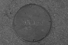 Sewer Lid in street Stock Photos