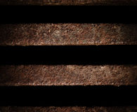 Sewer Line Abstract. A detailed close up macro photograph of a rusted iron sewer grate. A great texture image for a background or overlay royalty free stock images