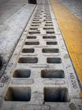 Geometric sewer on the street royalty free stock photo