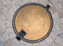 Sewer manhole on the street Royalty Free Stock Photography