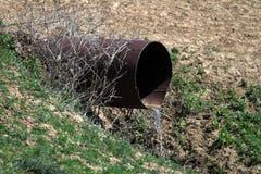 Sewer pipe wastes environment, natural water containment concept. Sewer pipe wastes environment, natural water containment royalty free stock photos