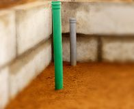 Sewer pipes in home basement. stock images