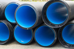 Sewer pipes of large diameter PVC. Corrugated water pipes of large diameter prepared for laying royalty free stock photography