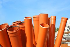 Sewer pipes. Stack of sewer pipes on site royalty free stock images