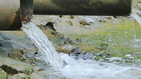 Sewer release wastewater into river. Sewage or domestic waste water