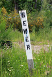 Sewer Sign. A stake, marking the sewer line at a new home construction site Stock Images