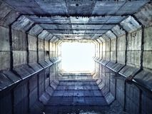 Sewer tunnel. Futuristic looking sewer royalty free stock photos
