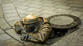 Sewer worker bronze. In the old town in Bratislava royalty free stock photos