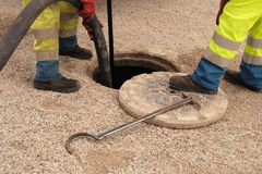 Sewer Workers In Action Royalty Free Stock Photos