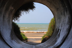 Sewerage. View of the pipe on the embankment Royalty Free Stock Image