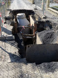Sewerage digging, open road construction site Royalty Free Stock Photo