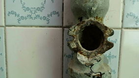 Sewerage pipe in the abandoned hospital. Smooth and slow dolly shot stock footage