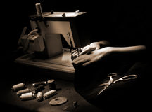Sewing. Sewer hands with sewing machine and accessories Stock Photography