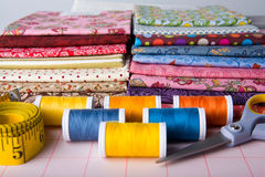 Sewing. Assortment of colorful fabrics and sewing tools Stock Photo