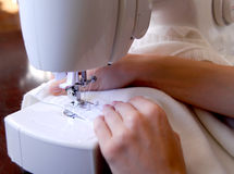 Sewing. Machine with young woman hands Stock Photography