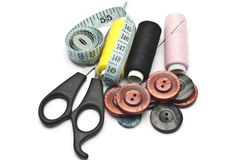Sewing accessories. Thread, scissors, buttons, and a centimeter - sewing accessories Stock Photos