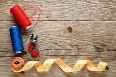 Sewing accessories. On wooden background Stock Image