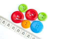 Sewing accessories. Multicolored buttons and garment inch needle Royalty Free Stock Photos