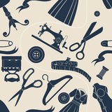 Sewing accessories beige background Royalty Free Stock Photo